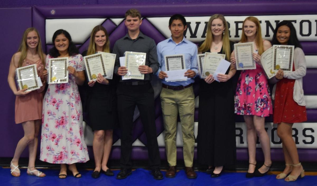 Students getting scholarships.