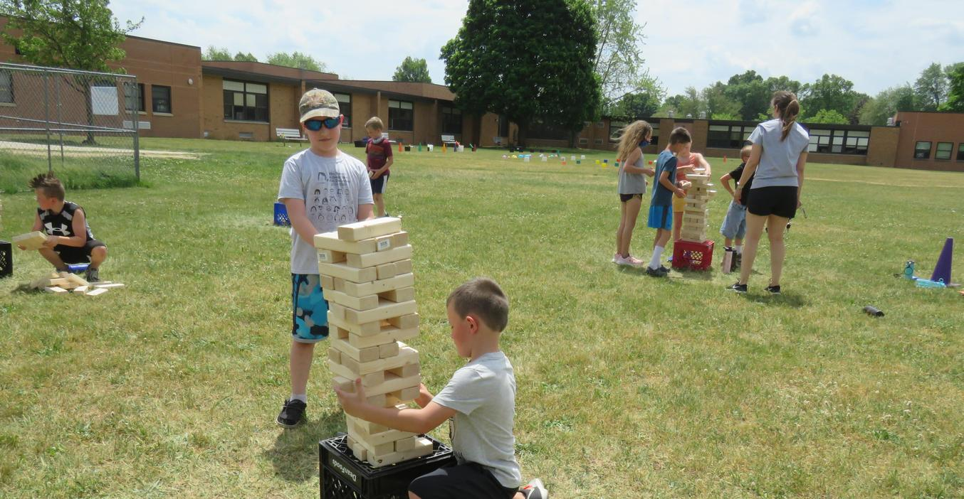 Lee students play giant yard Jenga games made by TKHS woods students.
