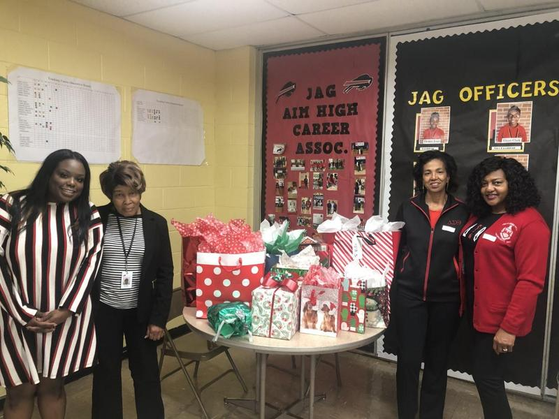 Baker Middle JAGS receiving Christmas gifts from the community