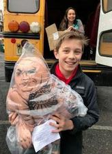 Photo of Franklin student holding toy to be donated.
