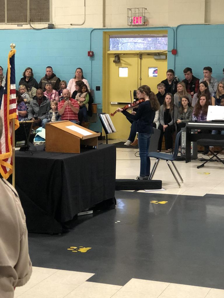 Young RCES girl plays the violin at RCES's Veterans Day Assembly