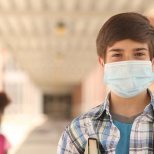 teen boy in face mask