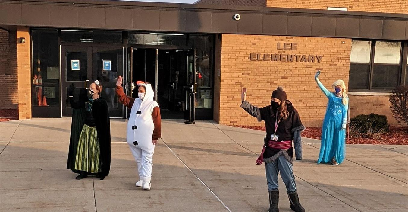 Lee staff dress up as the cast from Frozen to greet students to school.