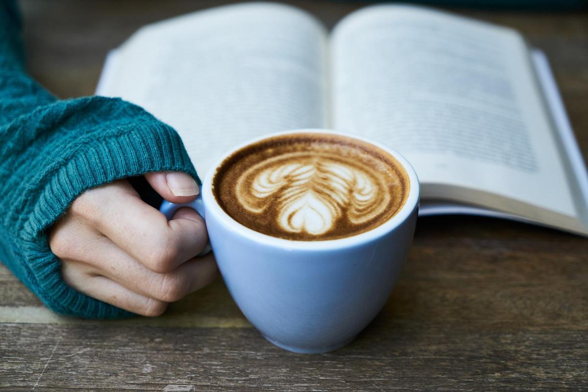 reading a book over coffee