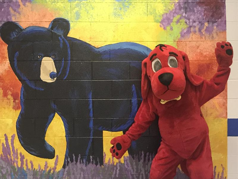 Clifford the Big Red Dog with our bear mural.