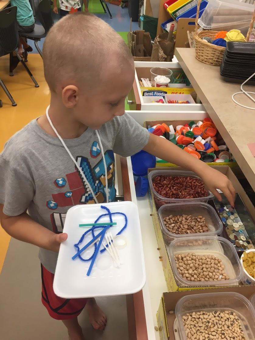 Student choosing makerspace materials