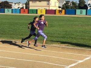 A 4th grade student running her race at the FMEA Track Meet.