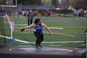 girl throwing at track meet