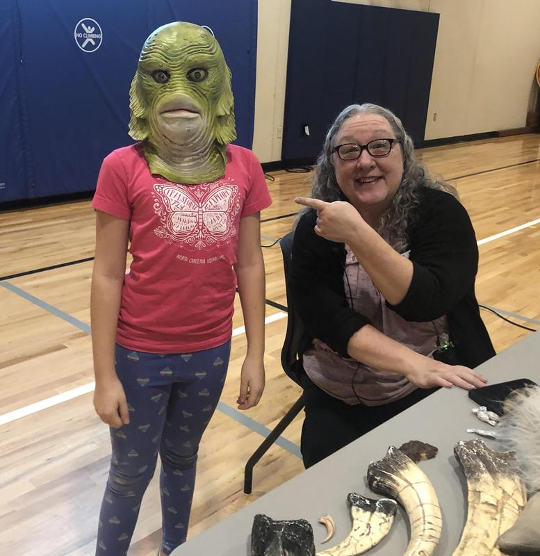 Author Kelly Milner Halls and an alien-masked student!