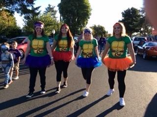 Office staff dressed as ninja turtles in parade