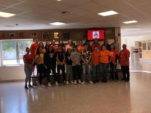 Group photo of students wearing orange shirts