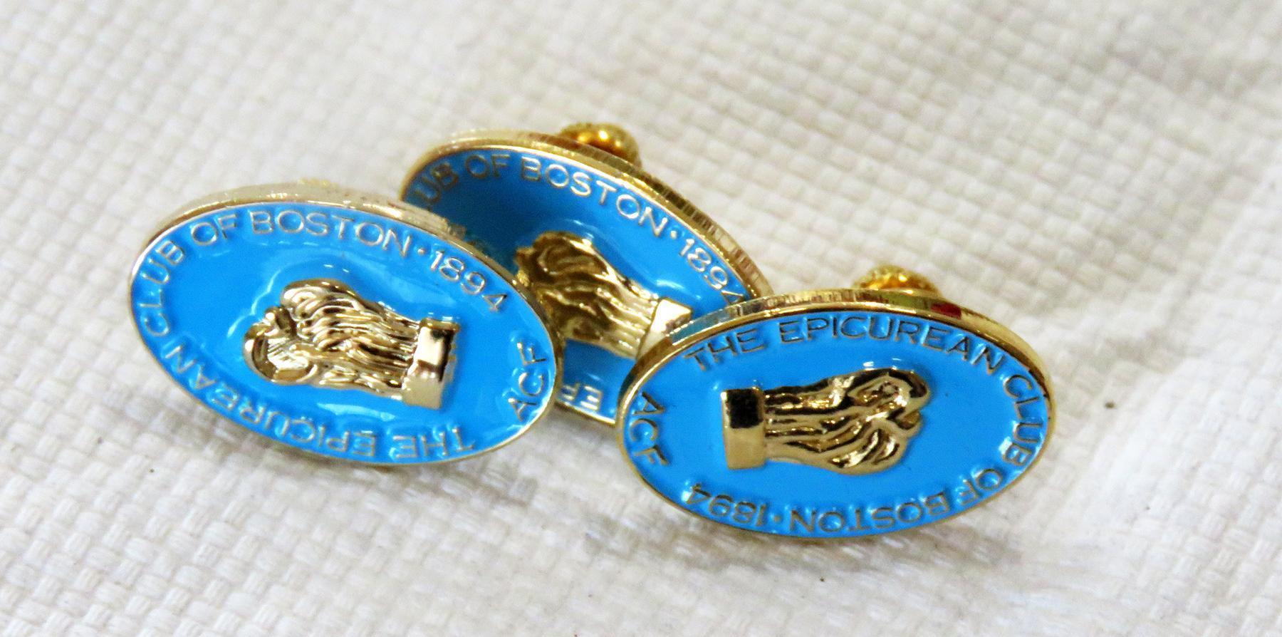 Closeups of three Epicurean Club of Boston pins