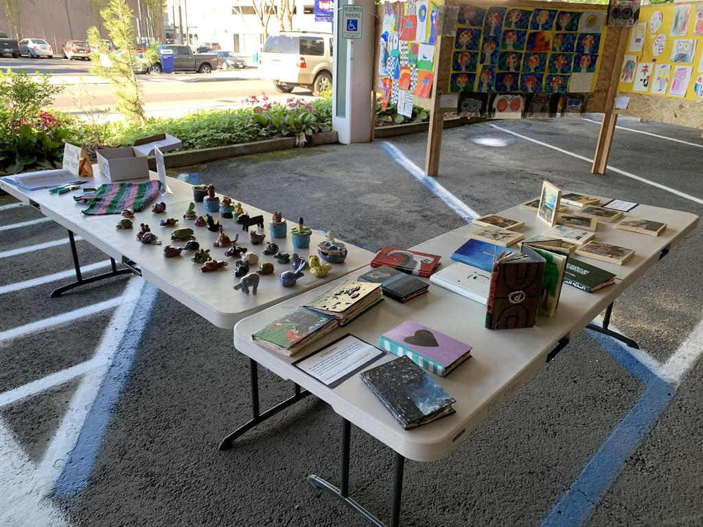 figurines and pieces of art displayed on tables