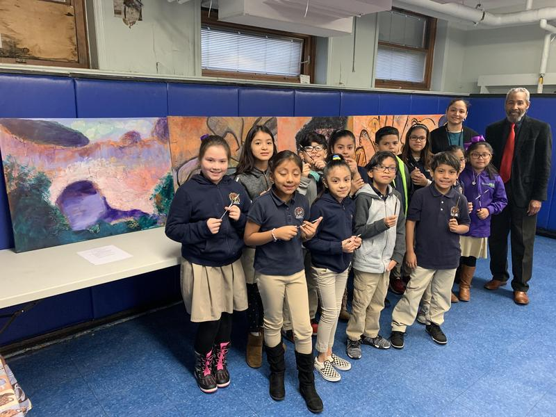 side picture group photo of several students with the art teacher and the artist Brooks