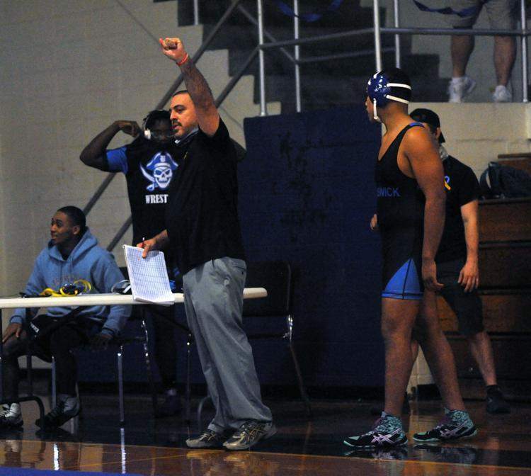 Brunswick High head coach Tommy Bartolotta raises his fist after a win earlier this season.