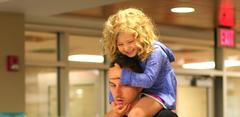 father with young daughter on his shoulders