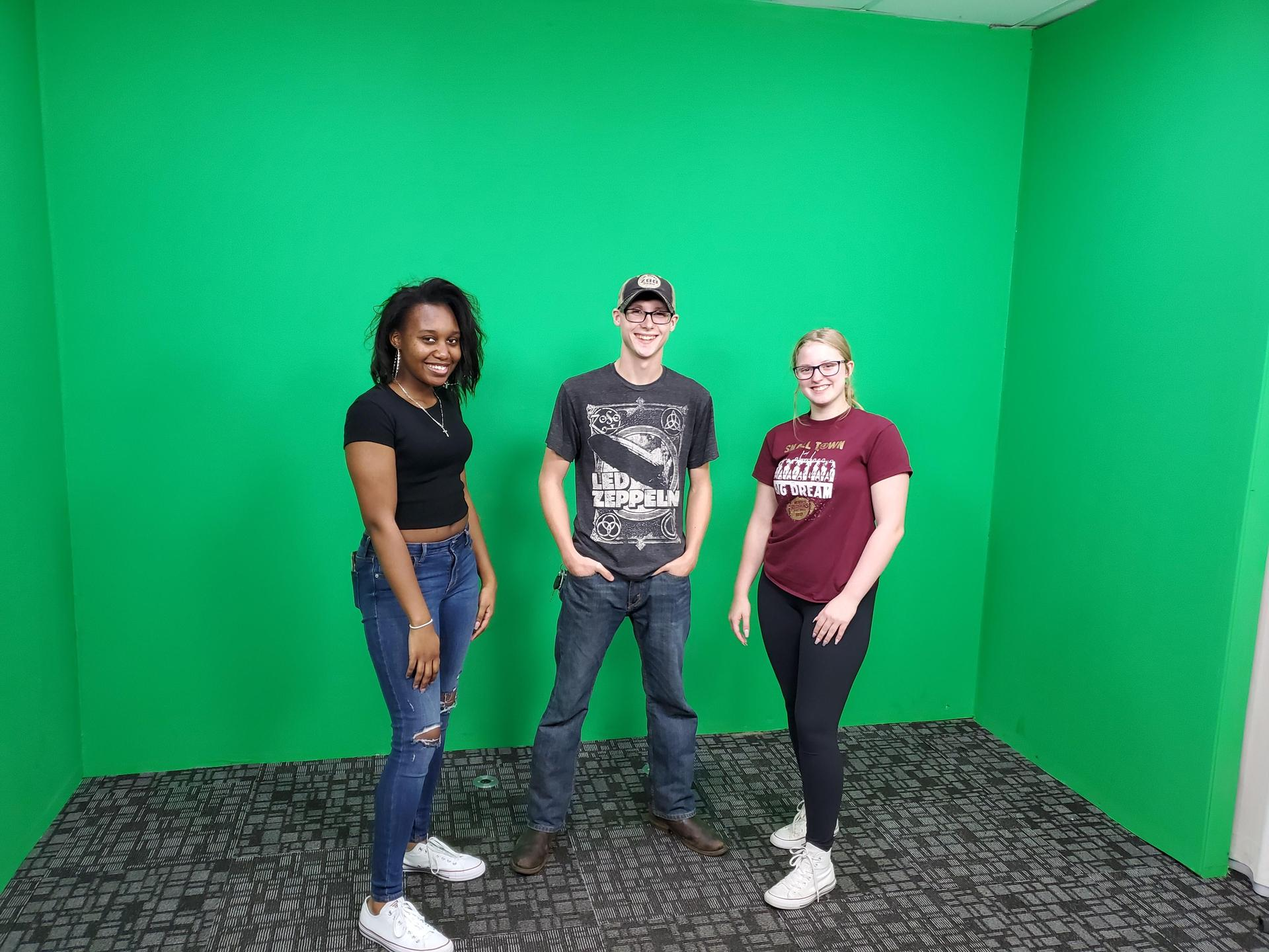 students in green screen room