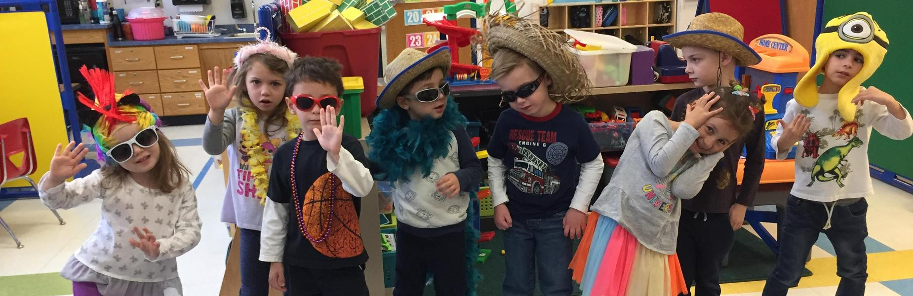 Pre-kindergartners have some fun with dressup at Lincoln School.