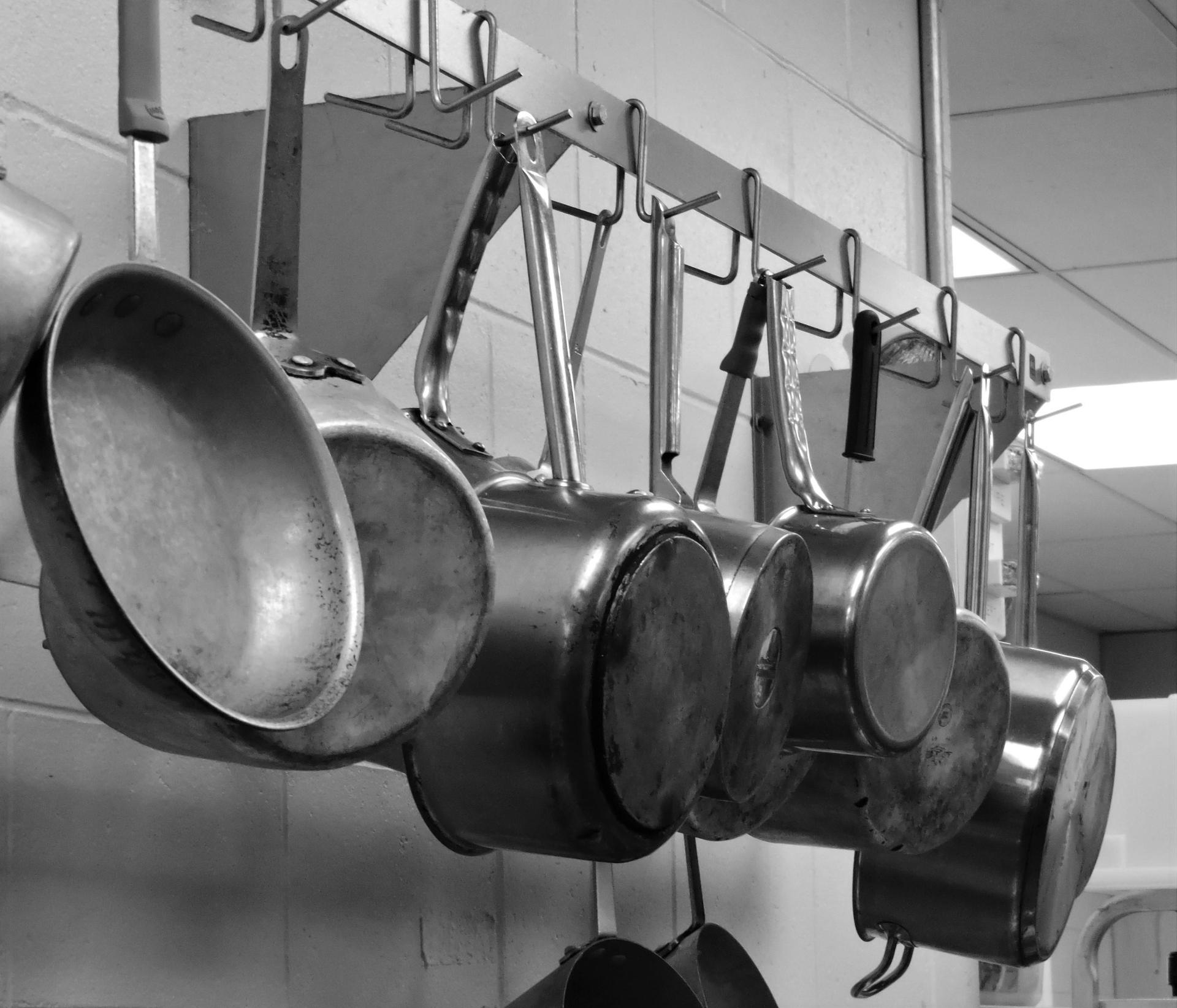 Pans hanging from rack