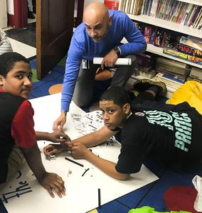 Students consulting with the Vice Principal on their projects