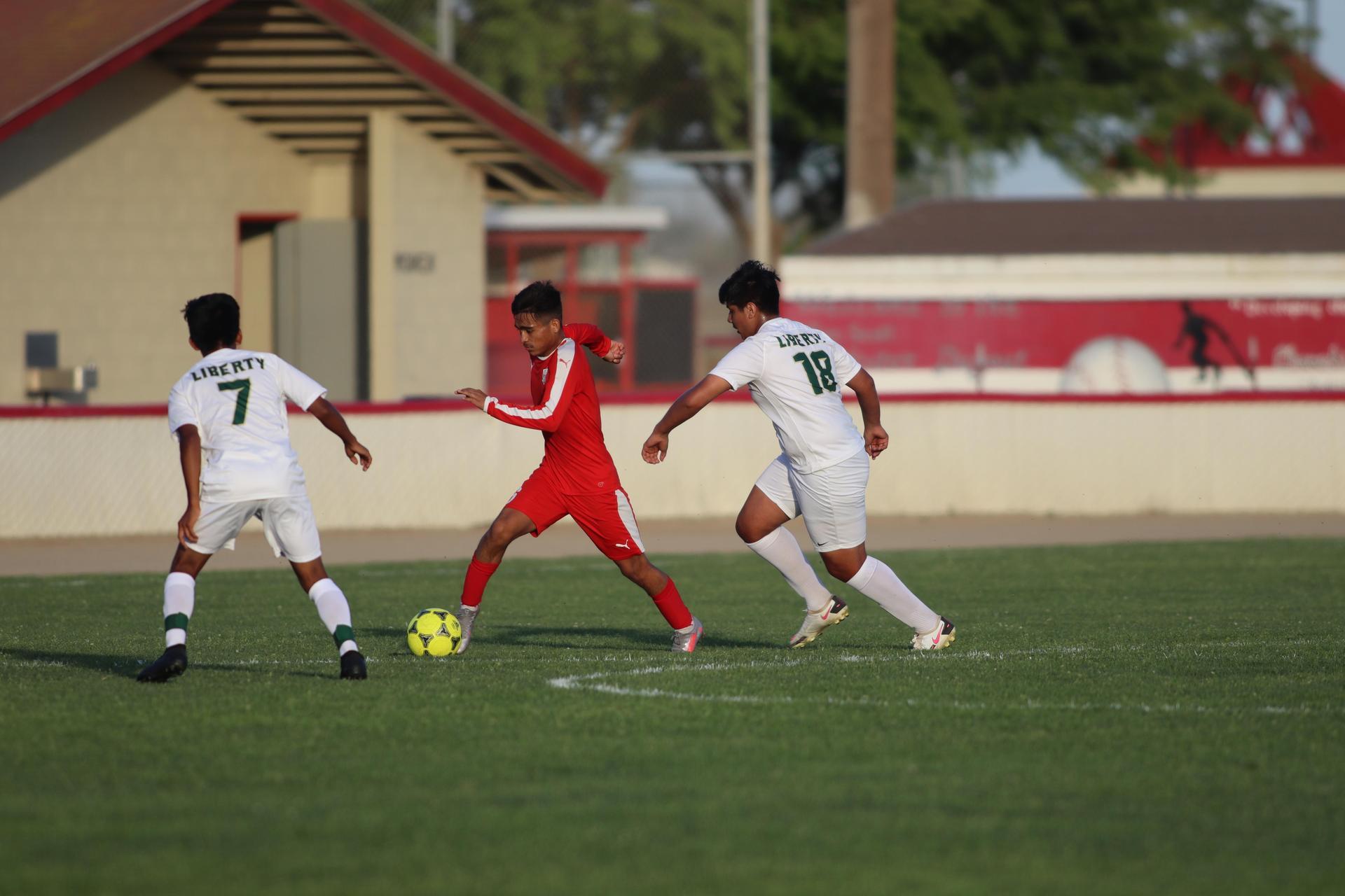 Boys playing soccer vs Liberty