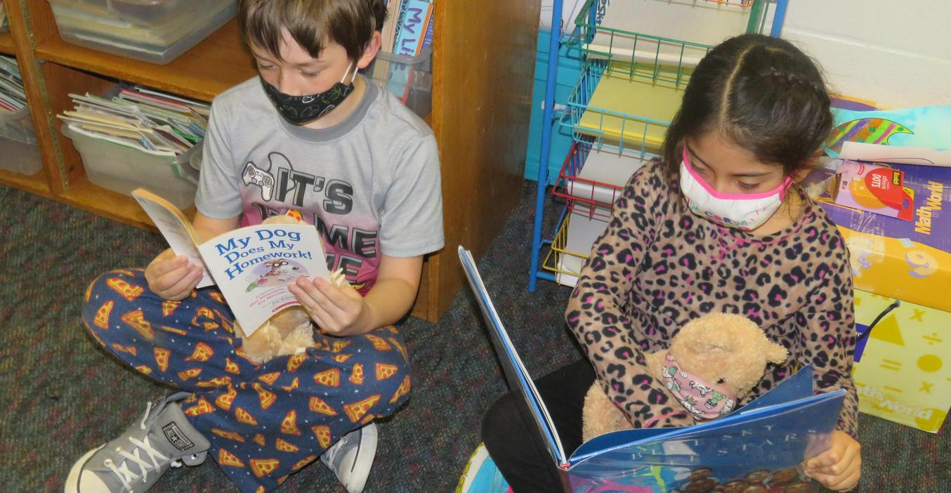 Lee students enjoy reading to their stuffed animals.