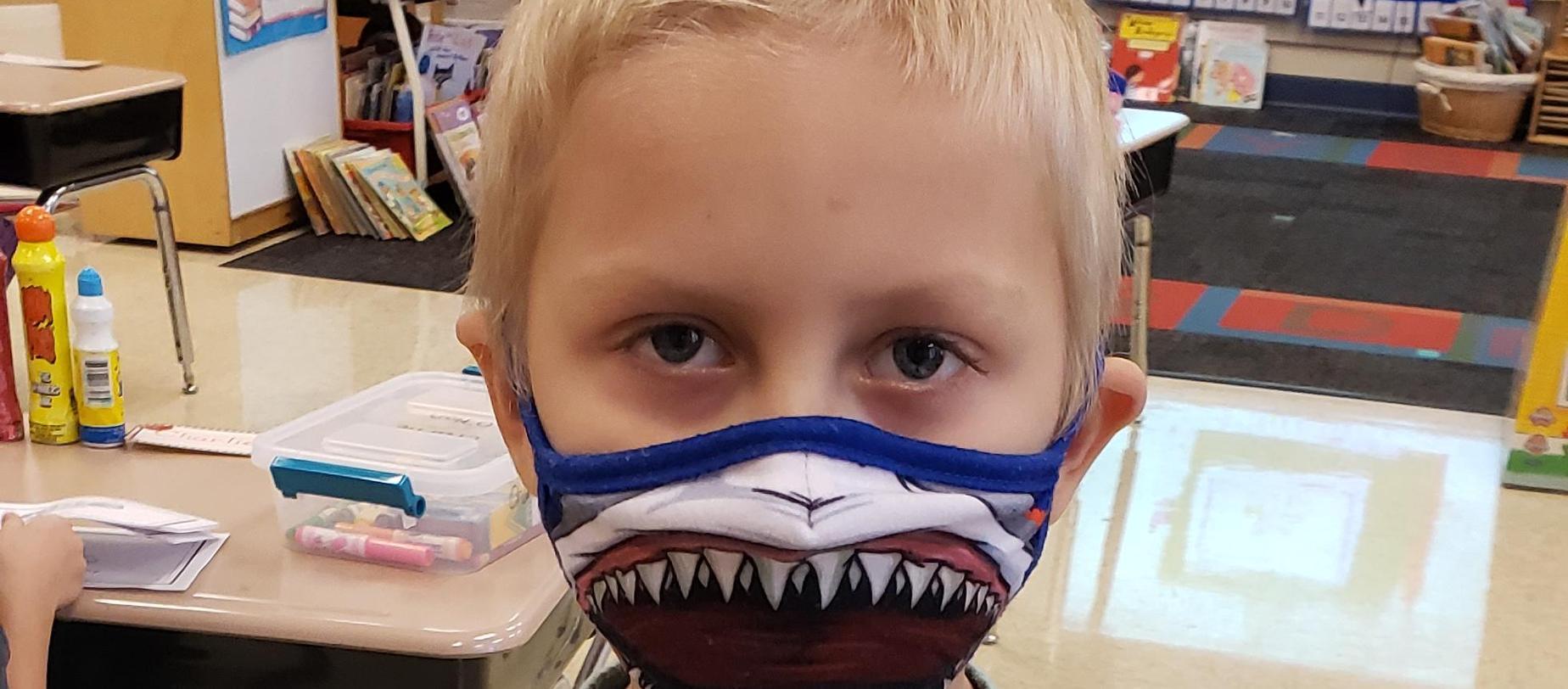 boy in mask posing for camera
