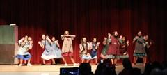 JMS drama students singing in the production of Annie.