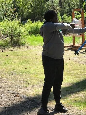 girl shooting a bow and arrow