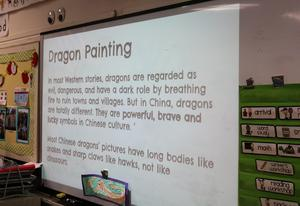 Photo of instructions and information about Chinese dragon, shown on a projection screen in 2nd grade classroom.