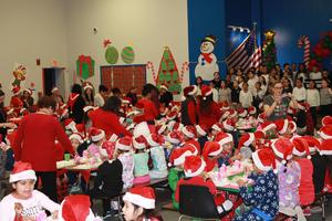 Children enjoying their breakfast with santa as the student choir sings