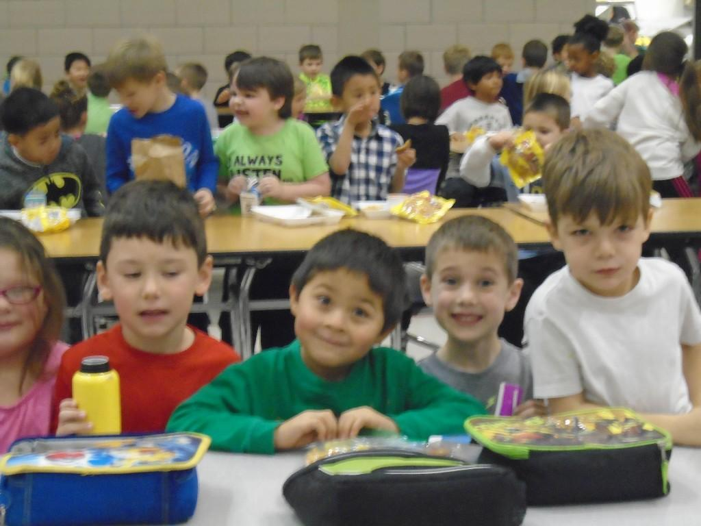 students eating lunch in lunchroom