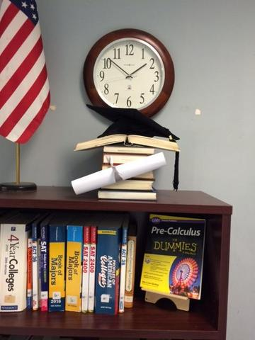 cap and clock on books