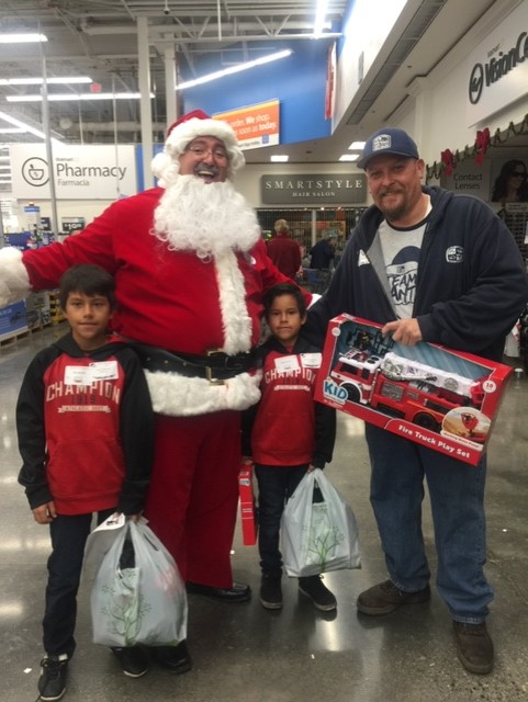 Santa with kenmore student and a volunteer