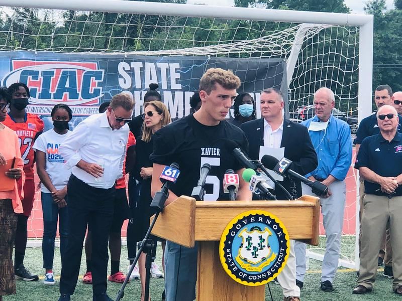 Xavier QB Drew Kron speaks at press conference to promote vaccinations for students and student-athletes. Gov. Ned Lamont and Lt. Gov. Susan Bysiewicz also spoke.