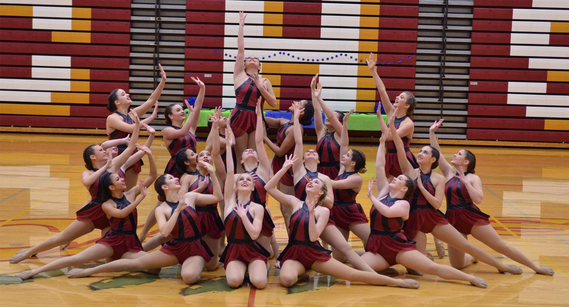 The Columbia High Dance Team strikes a pose at the end of a routine.