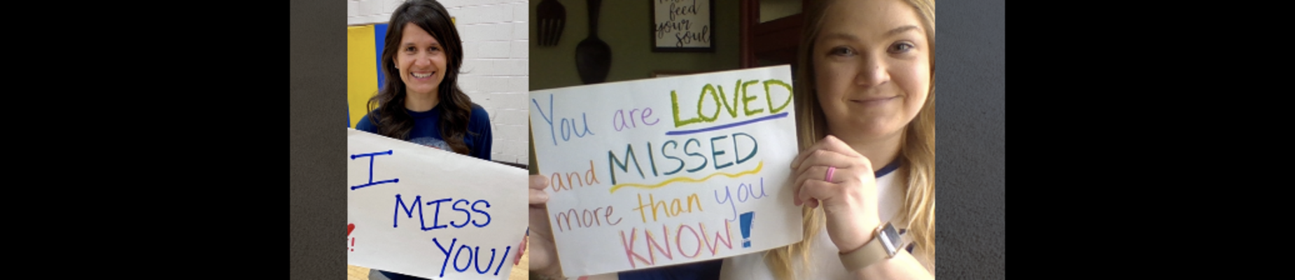 2 teachers holding I miss you signs