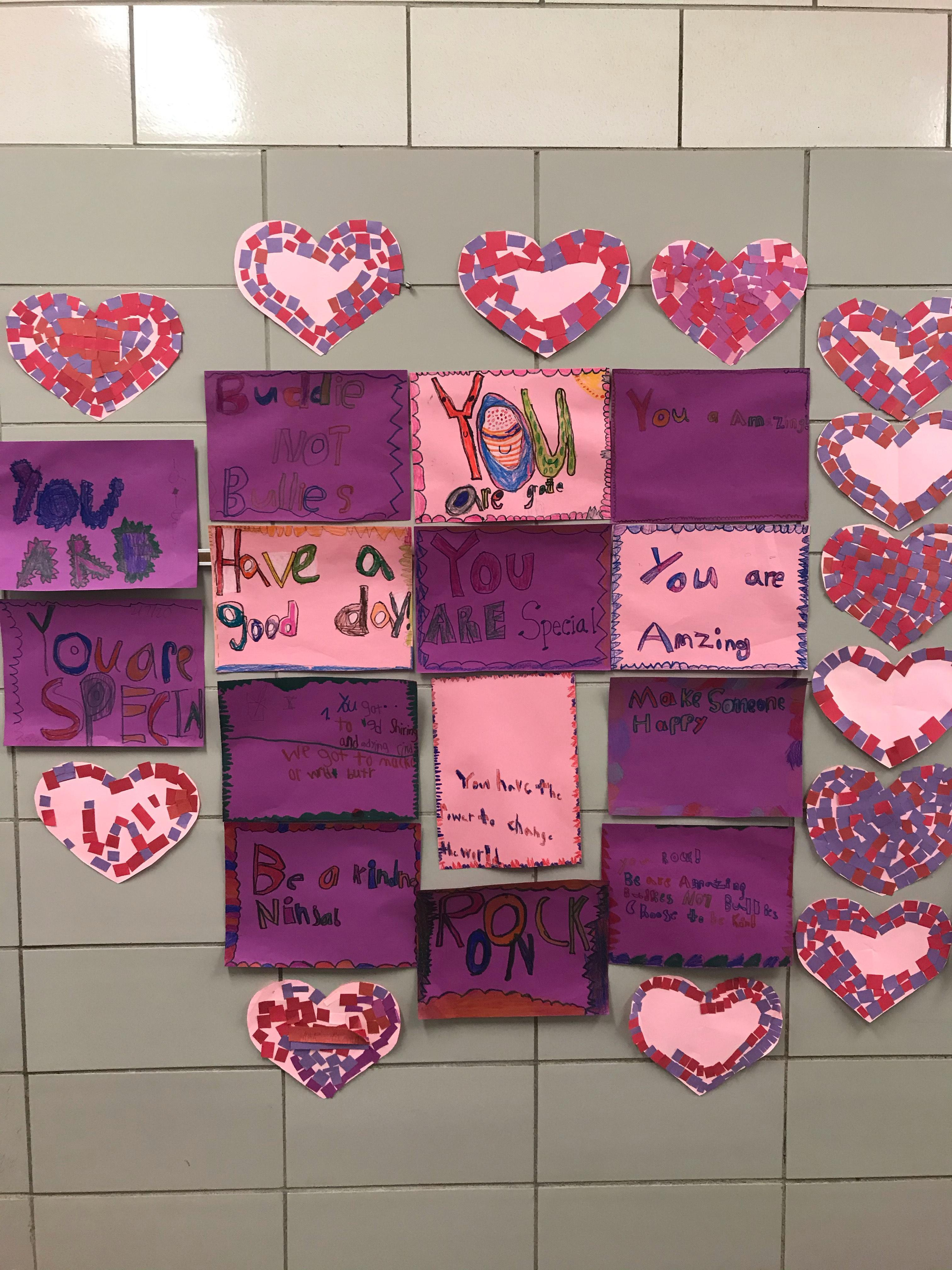 bulletin board with messages of kindness for PS I Love You Day