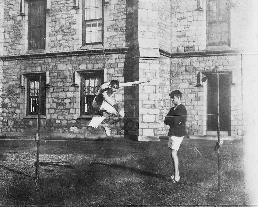1911 photo of a student doing a high jump
