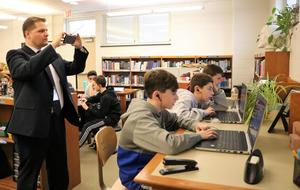 New Jersey Department of Education Deputy Assistant Commissioner Dr. David Greer visited Roosevelt Intermediate School on Dec. 5, as 8th graders used coding building blocks to create an animated dance party, just one of the many Hour of Code activities taking place across Westfield Public Schools during Computer Science Education Week.  Pictured here is the deputy assistant commissioner taking a photo of the activities.