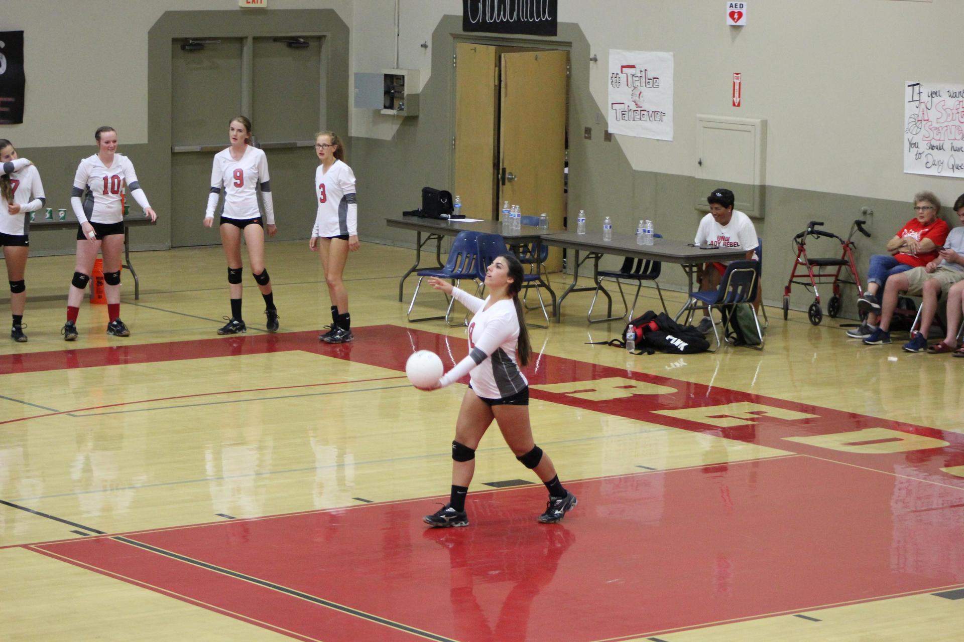 Girls playing volleyball against Yosemite
