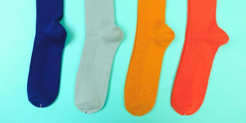 four socks blue aqua yellow red
