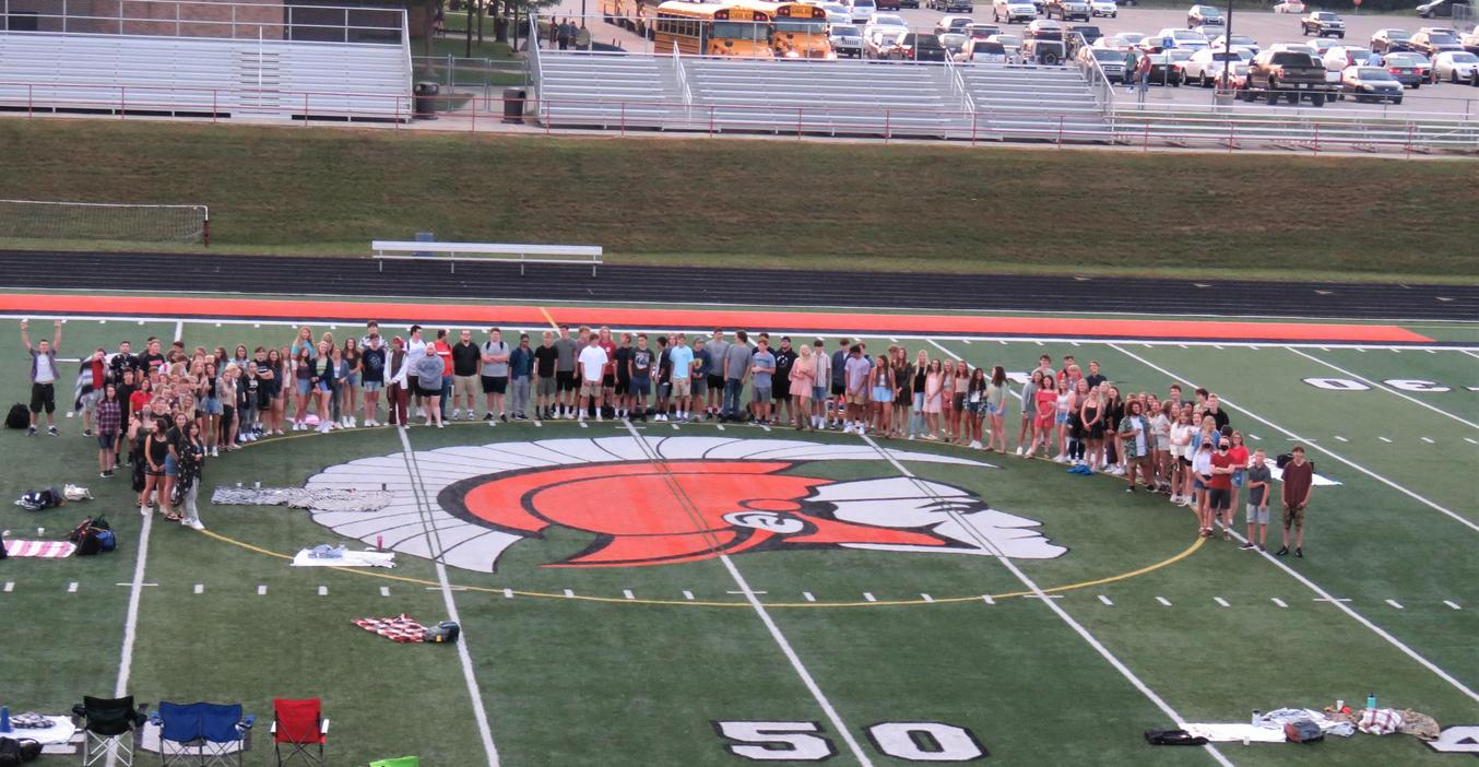 TKHS seniors gather in the stadium before their last first day of high school.
