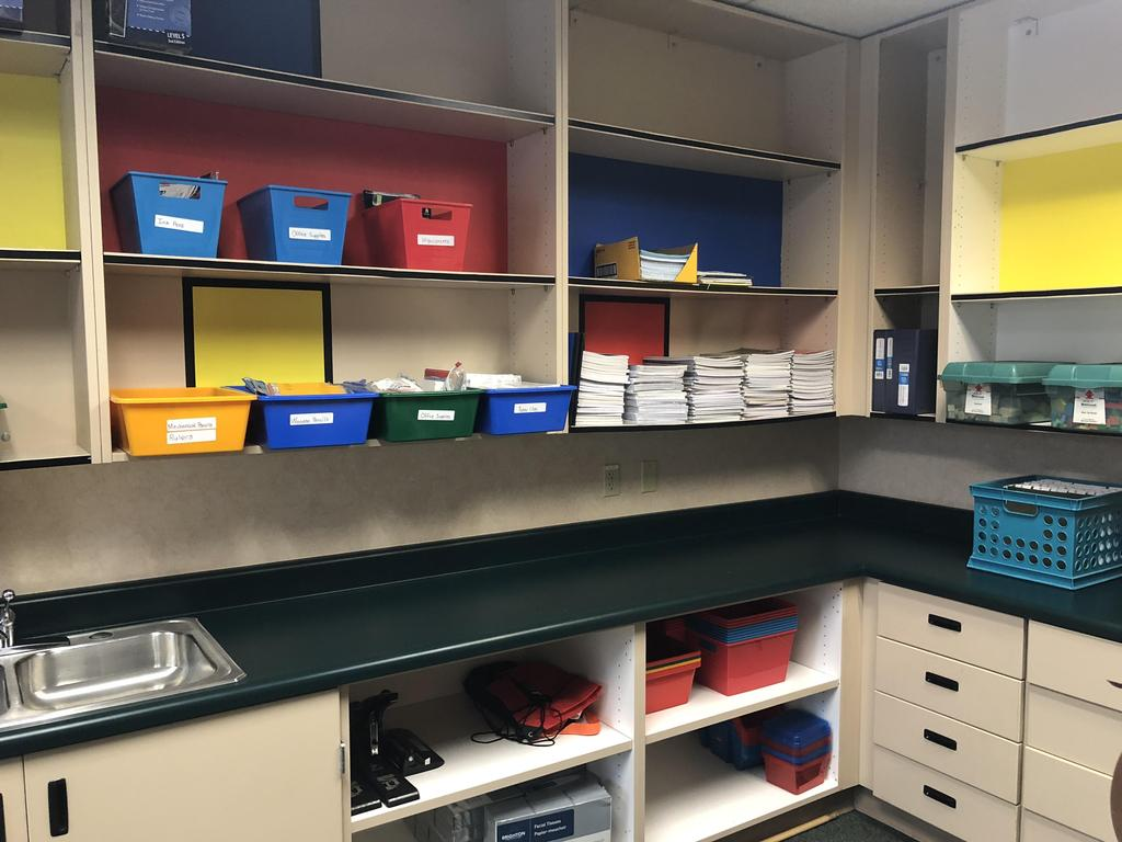 work room stocked with new organizational bins