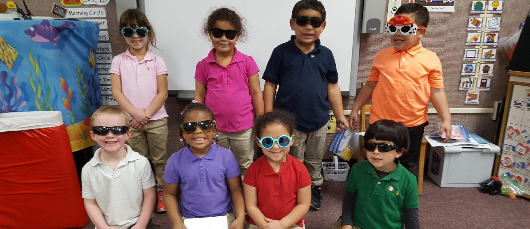 pre-k students posing with sunglasses on