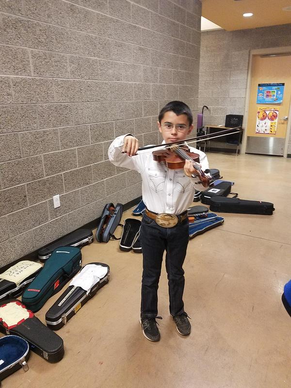 student playing an instrument