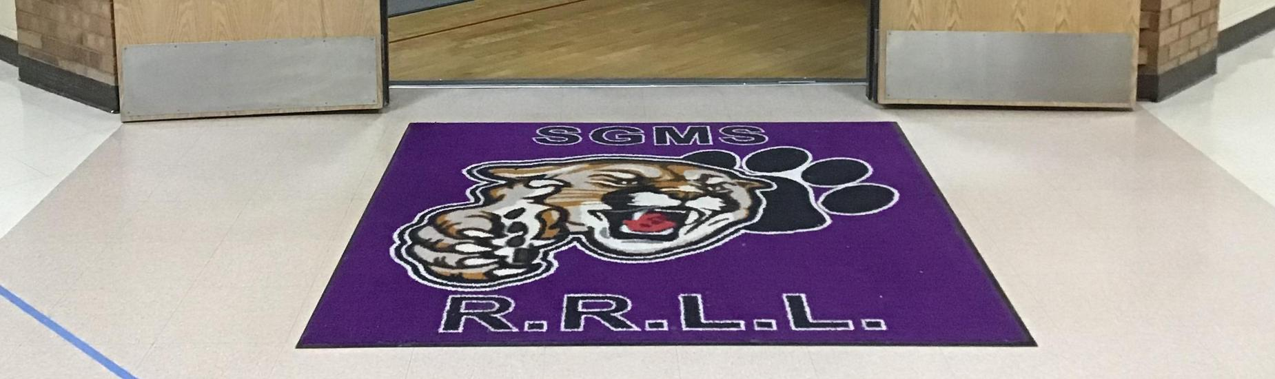 SGMS Cougar on a floor mat