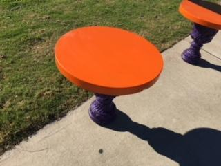 Masonry student concrete Clemson table with an orange top and purple base.