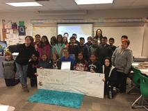 Mrs. Mast receiving the United Way Volunteer of the Year award with her class.