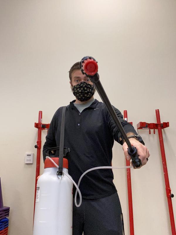 Mr. Harney with cleaning equipment